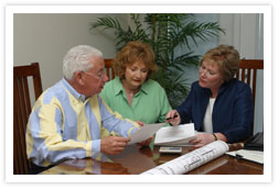 Heather Lord REALTOR discussing an Offer with clients Office